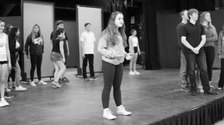 Junior Brigid O'Brien rehearses a scene along with fellow cast members. [Tobey Reyes]