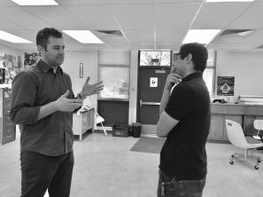 Senior Fernando Carmona talks to ELD teacher Ryan Berberian about the program's faults. [Ally Valiente]