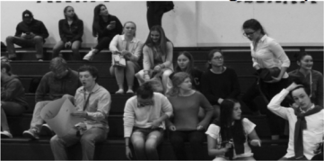 The crowd during the halftime of the girls basketball game is much smaller than that at the boys basketball game. [Jenna Clark]