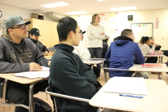Freshman Addison Chen (center) participates in his ELD class. [Ally Valiente]